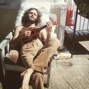 Nate playing the ukulele